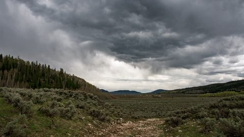 Dark Stormy Time Lapse of Dark Dramatic Clouds moving through the sky in the Wyoming landscape.