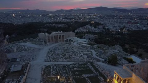 The temple of Erechtheio on athenian Acropolis. Aerial 4k drone shot from above. Sunset over greek capital