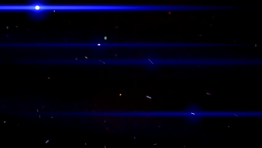Flow colored dust particles with blue light rays on black. Motion graphic. | Shutterstock HD Video #1012397486