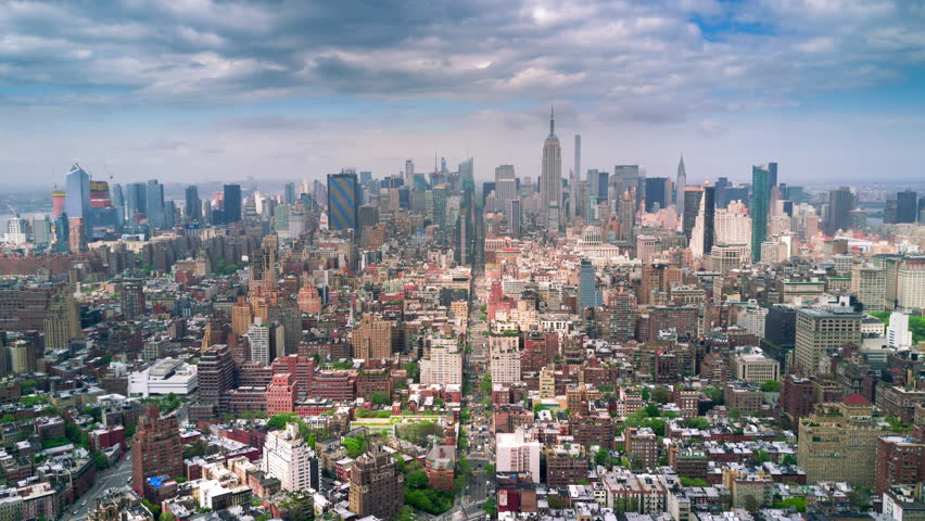 Aerial view of Manhattan, New York City. Tall buildings. Sunny day, aerial timelapse dronelapse. Clouds on background. | Shutterstock HD Video #1012402196