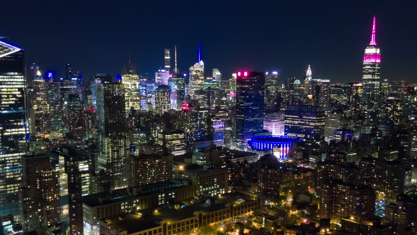 Aerial night view of Manhattan, New York City. Tall buildings. Timelapse dronelapse. NY from above. | Shutterstock HD Video #1012402226