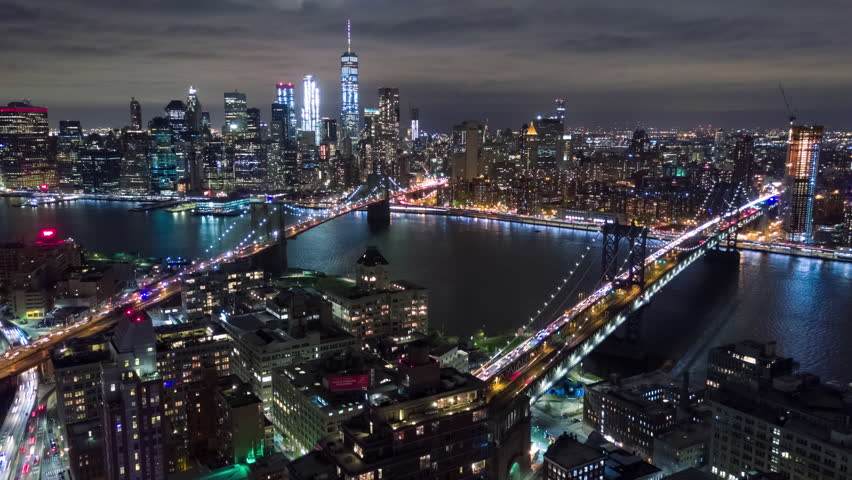 Aerial night view of Manhattan, New York City. Tall buildings. Timelapse dronelapse. NY from above.