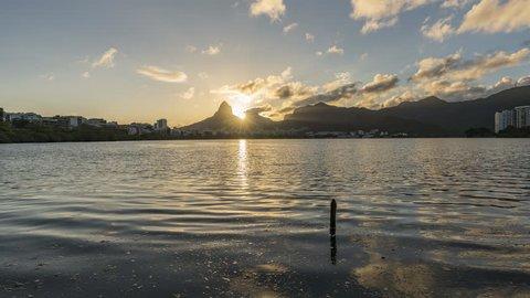 Sunset over Rio De Janeiro Mountains and Lagoa Rodrigo de Freitas Lake , Brazil. Wide angle Timelapse