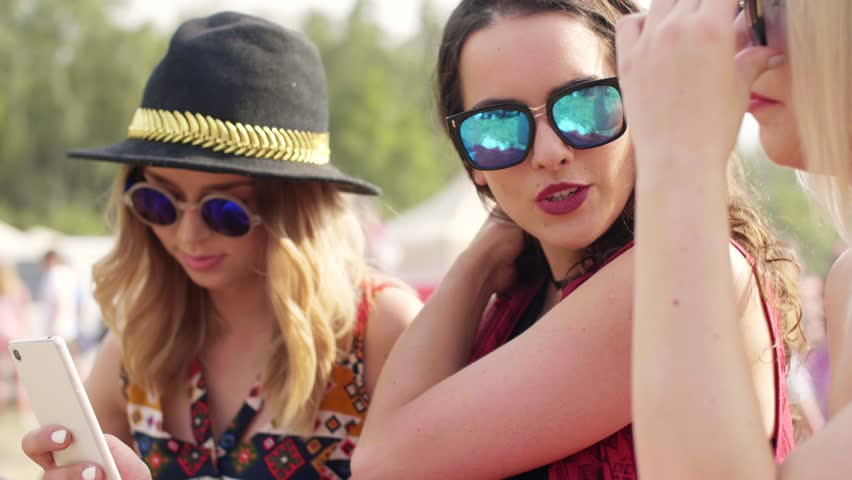 Hipster friends making a selfie at the summer  festival #1012445936