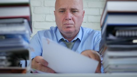 Businessman Archiving Work Sort Documents and Invoices