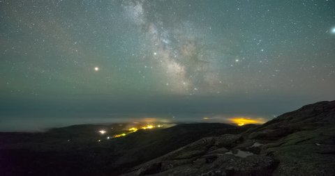 Fog and the Milky Way rising viewed from Cadillac Mountain in Maine