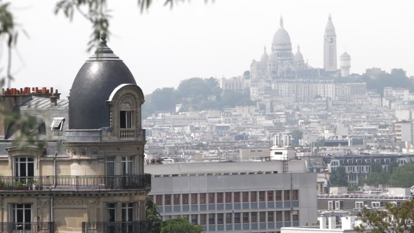 Skyline of Paris. A view from Parc des Buttes Chaumont on Basilica of the Sacre Coeur. Slow pan. | Shutterstock HD Video #1012490486