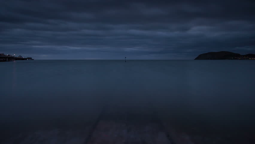 4k time lapse of the ebbing tide on a jetty at Llandudno, North Wales coast