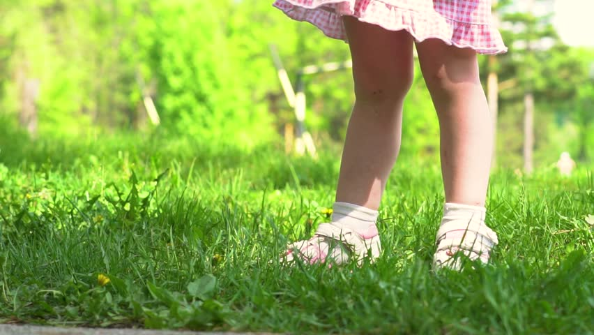 child's feet running #1012534886