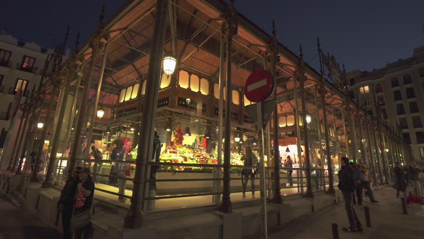 Famous San Miguel market, mercado at night - April 2018: Madrid, Spain | Shutterstock HD Video #1012548056