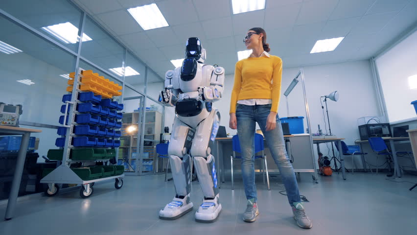 A robot spanks a woman on the buttocks, then she gives it a slap. 4K.
