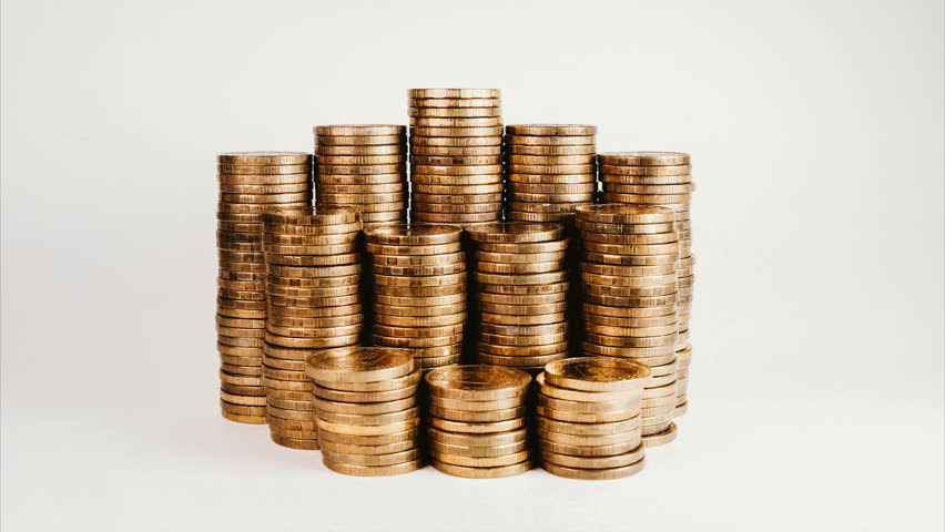 Stop motion reduction of a pile of gold coins, reduced investment and reduced profits on a white isolated background. | Shutterstock HD Video #1012621856