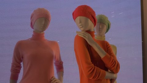 Colorful female mannequins on a noise video background