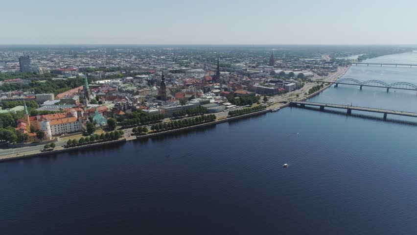 Slowmotion Riga City Bridges drone Flight Old town air flight with buildings and cars near daugava river and Library | Shutterstock HD Video #1012658576