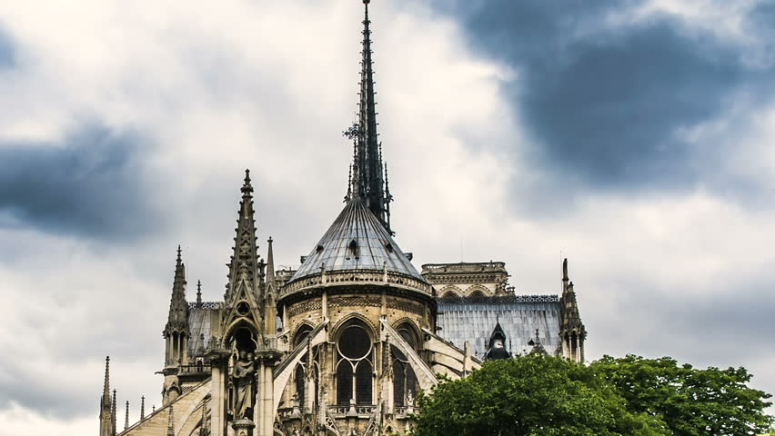 Spire and east side of Notre-Dame cathedral gothic style in architecture, travel | Shutterstock HD Video #1012663736