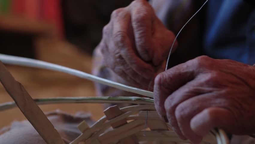Basket master makes a wooden basket in his workshop. | Shutterstock HD Video #1012750556