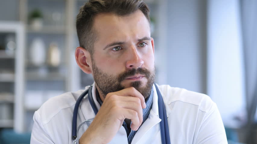 Pensive Doctor Thinking about Patient Health | Shutterstock HD Video #1012753976