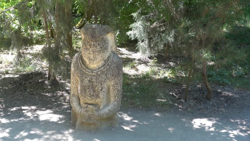 Kherson region, Ukraine - 3d of June 2018: 4K Tour to the  Askania-Nova reserve - Antique Polovtsy stone sculpture in the national park  #1012770866