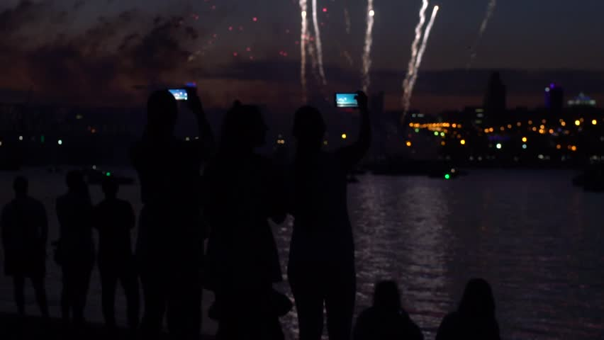 A group of people during a firework near a river. Festive fireworks. slow motion | Shutterstock HD Video #1012796756
