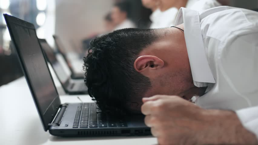 Overwhelmed stressed employee feeling angry at work in office. Close-up of worker tired on his hated work. | Shutterstock HD Video #1012830356