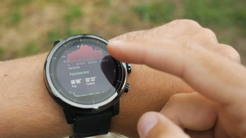 Results of a running training session on smart watch. Smartwatch. Hand with sports watch which shows results of training. Pulse, speed, distance, calories