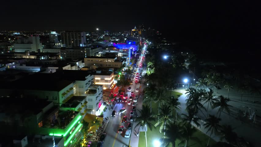 Drone footage South Beach Ocean Drive night neon