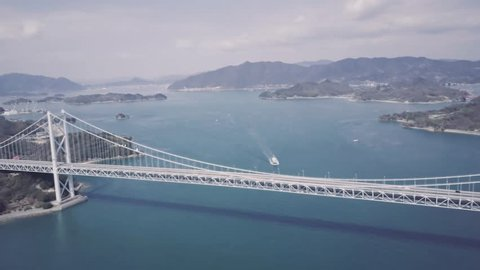 Great Naruto bridge in Tokushima Japan aerial view with boat passing under bridge.