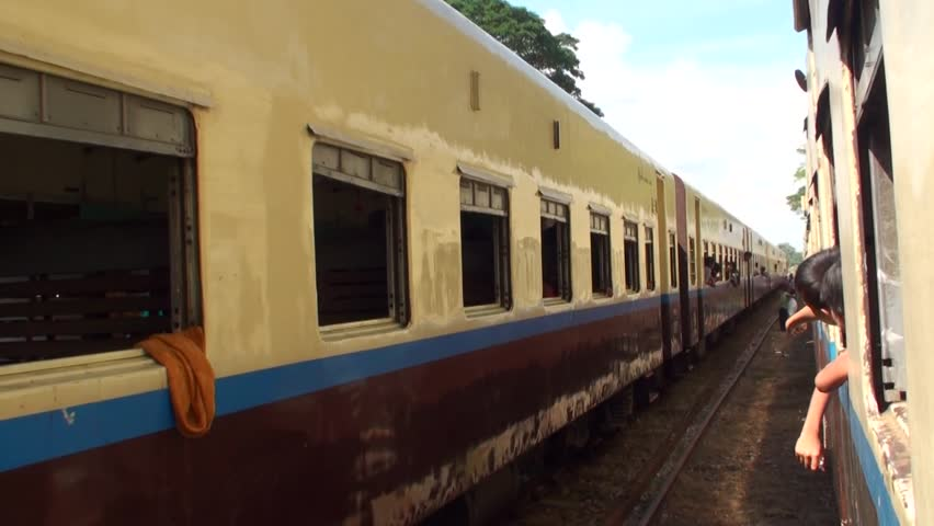 Kinpun Kyaiktiyo , Môn /Myanmar (Burma) - 12/01/2017 : old train in Burma with summary comfort; picturesque countryside landscapes and we cross poor villages. Sellers of all kinds circulate there.  | Shutterstock HD Video #1012928486