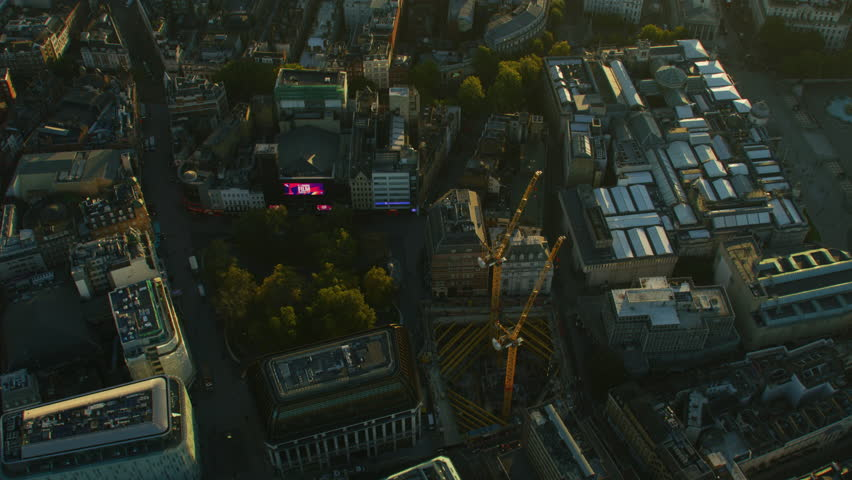 London, UK - November, 2017: Aerial sunrise view London city rooftops to financial districts and commuter travel across River Thames England United Kingdom RED WEAPON | Shutterstock HD Video #1012933346