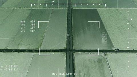 Night vision helicopter / drone / UAV tracks van through farmlands, police / military concept.
