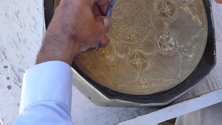 Craftsman engraving patterns on the tray. masters of Central Asia and Uzbekistan. manual copper minting. the old art of etching on utensils | Shutterstock HD Video #1013024156
