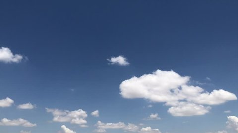 Cloudy time lapse, Seamless Loop Clouds,Towering Cumulus Cloud Billows Time Lapse, Seamless, Beautiful white cloudscape soar across the screen in time lapse fashion over a deep blue background. UHD