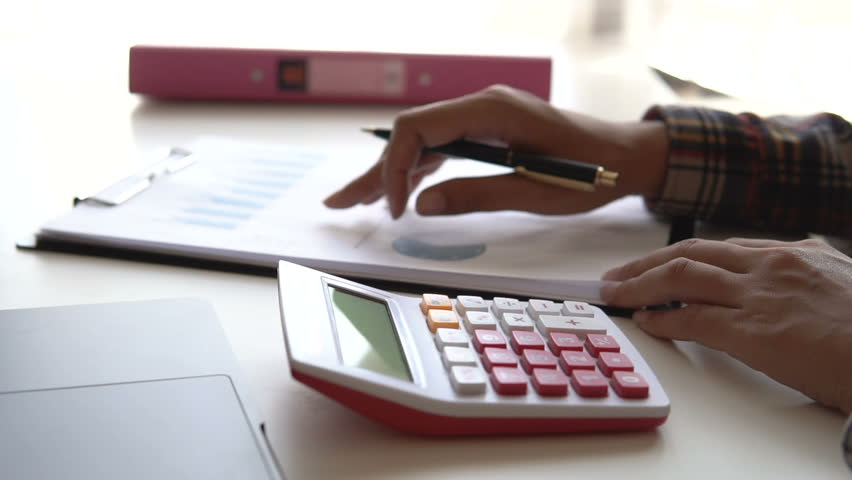 Closed up man calculate about finance report at office, Finance managers task, Concept business and financial investment