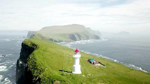 Aerial view of the impressive coastline of Mykines island in Faroe Islands.