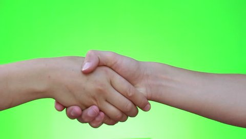 Handshake, shaking hands, handshaking. Two handed gesture. Chromakey. Green Screen. Isolated