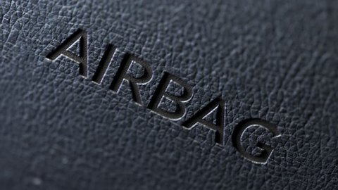 03515 Close up shot of airbag sign on a dashboard.