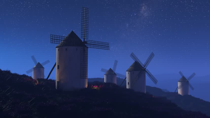 03492 Vintage agriculture windmills rotating slowly at night with stars in the background.