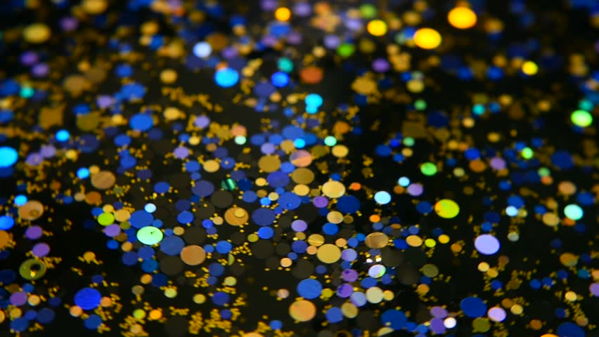 Defocused shimmering multicolored glitter confetti, black background. Party, magic, imagination. Rainbow colors, sparkle circles. Holiday abstract festive texture of shiny blurred bokeh light spots. | Shutterstock HD Video #1013158976