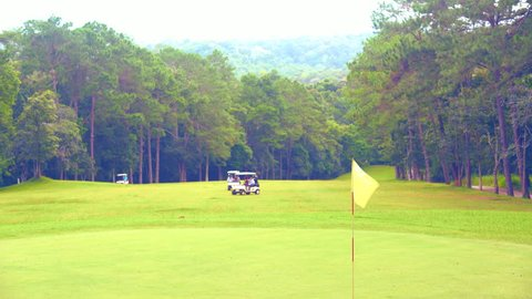 Golf course for golfer playing is beautiful and this sport in forest on mountain of vacation or relax in summer holiday. It beautiful fairway and layout for golf cart transfer in this golf course.