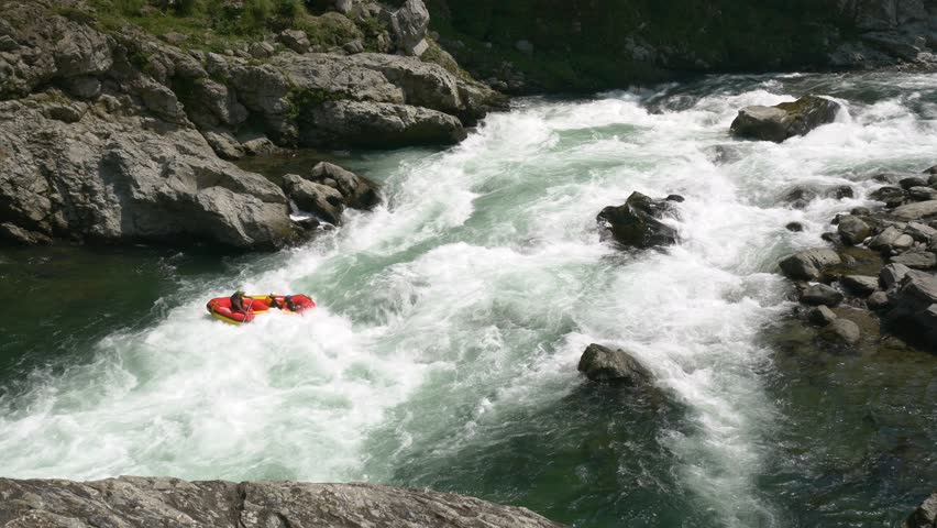 Three rafters battle the whitewater on the Yoshino River in Tokushima Japan | Shutterstock HD Video #1013168426