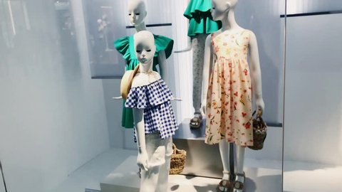 dummy in the shop window. beautiful, expensive, fashionable clothes are shown on a boutique showcase