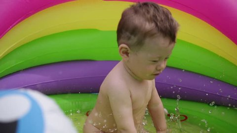 child mestizos in the children's pool.one-year-old child, Asian appearance.