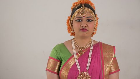 Indian girl showing different moods using traditional Bharat Natyam dance form. Sad expression.