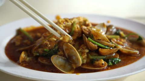 Chili sauce sambal clam Singaporean Malaysian seafood dish in hawker food centre
