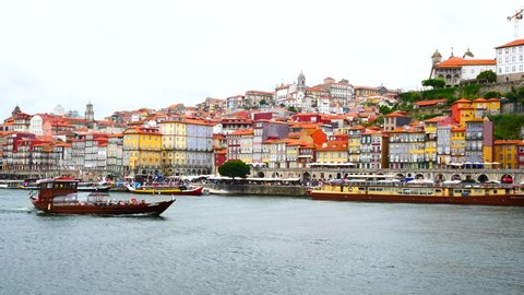 Porto, Portugal skyline time lapse on the Douro River with traditioanl gondolas