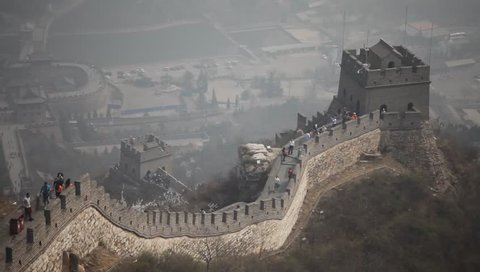 Unrecognizable tourists climbing the Great Wall near Beijing in China
