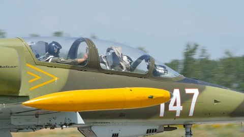 Close Up of Pilots of a Military Aircraft Aero Vodochody L-39 Albatros after Landing in Slow Motion. L-39 is a Soviet Era Jet used by Warsaw Pact Air Forces. Graf Ignatievo Bulgaria 26 June 2016