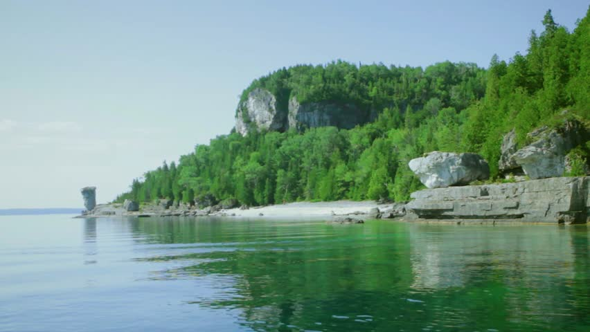 Boat arriving at Flowerpot Island, Bruce Peninsula, Ontario, beautiful blue water, landscape