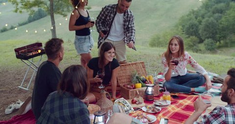 Group of friends spending time making a picnic and a barbeque. shot in slow motion
