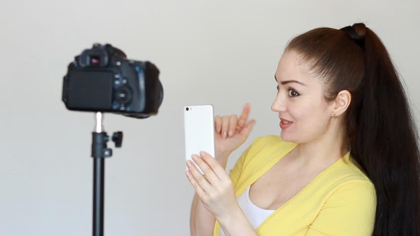 Girl blogger advertises mobile phone. Advertising smartphone for the Internet. | Shutterstock HD Video #1013409686